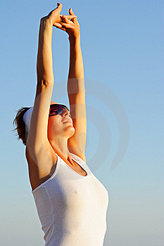 Girl With Arms Raised Towards The Sky Stock Image - Image: 20657941
