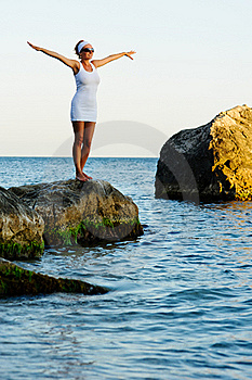 Girl With Arms Raised Towards The Sky Royalty Free Stock Photography - Image: 20658077