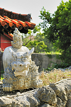 Shi-sa- Of Stonework And Vermilion Roof Stock Image - Image: 20662761