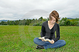 Reading On The Meadow Royalty Free Stock Photo - Image: 20712105