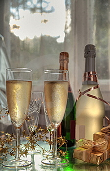 Champagne In Glasses, Gift Box And Sunbeam Royalty Free Stock Photos - Image: 20742098