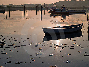 Reflection Of A Small Dinghy Dory Boat Royalty Free Stock Photos - Image: 20742268