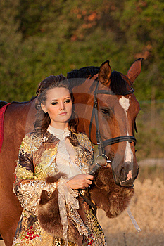 The Woman In Clothes Of 18 Centuries With Horse Stock Image - Image: 20744091