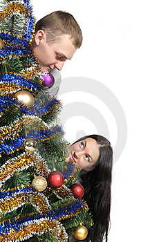 Man And Woman Near Christmas Tr Stock Photos - Image: 20754983