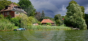 Houses On A Lake Royalty Free Stock Photo - Image: 20755435