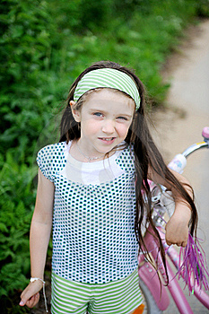 Long-haired Child Girl Poses With Pink Bycicle Royalty Free Stock Photos - Image: 20757828