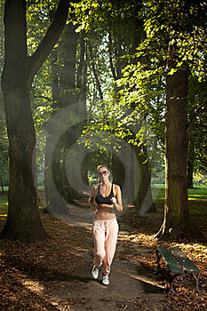 Woman Jogging In The Park Royalty Free Stock Photo - Image: 20763125