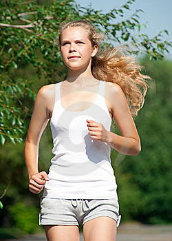 Girl Jogging In Summer Park Stock Photos - Image: 20764793