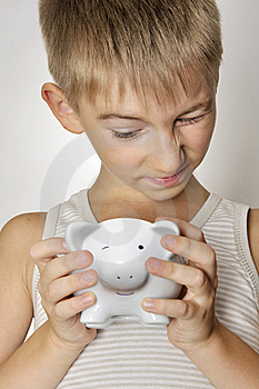 Boy With Piggy Bank Royalty Free Stock Images - Image: 20779899