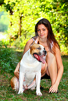 Girl With Dog In A Park Stock Photo - Image: 20785960