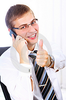 Businessman Shows OK Sign While Calling By Phone Royalty Free Stock Photos - Image: 20826378
