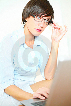 Beautiful Girl With Glasses Working On Laptop Royalty Free Stock Photos - Image: 20853418