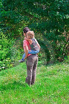 Mother And Son In A Green Forest Royalty Free Stock Images - Image: 20868379