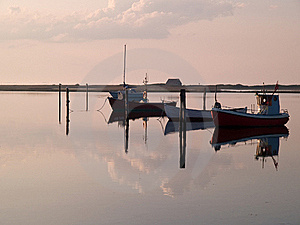 Reflection Of A Small Dinghy Dory Boats Stock Photography - Image: 20893342