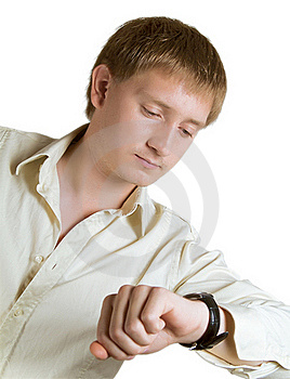 The Man Looks At A Watch Royalty Free Stock Photo - Image: 20908375