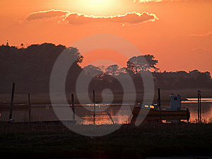 Boats In An Amazing Sunset Royalty Free Stock Photos - Image: 20948668