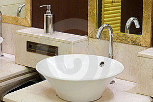 Washbasins, Taps And Mirror In Public Toilet Stock Image - Image: 20965541