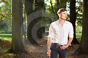 Man Walking In The Park At Sunrise Stock Images - Image: 20966654
