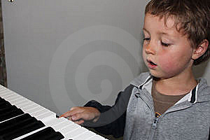 Child Learning to Play Piano Free Stock Photos