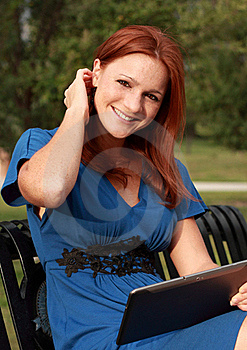 Pretty Woman Holding Tablet Stock Images - Image: 20985784