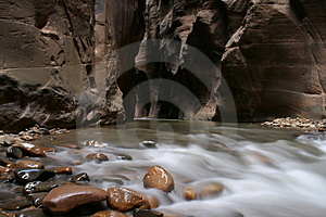 River Coming Out Of Rock Stock Photography