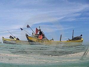 Рыболовные сети объявления шлюпки Стоковое фото RF