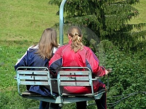 Two Girls On A Chair-lift In Summer Free Stock Photography