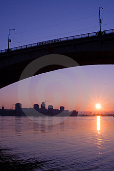 City on the river in sunrise Royalty Free Stock Image