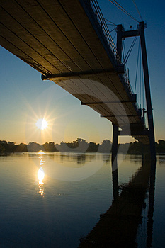 Suspension Bridge In Sunrise Stock Photo