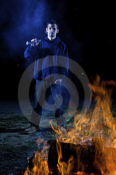 Axe Wielding Maniac By A Fire Stock Photos - Image: 21005043