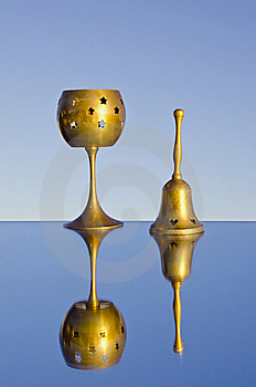 Two Brass Objects On Mirror Stock Photo - Image: 21021490