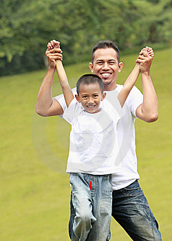 Man And Young Boy Playing Stock Photos - Image: 21021493