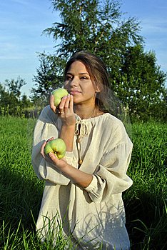 Girl In A Linen Shirt, Holding Apples Royalty Free Stock Photos - Image: 21022258