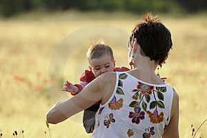 Mother And Daughter In A Poppy Field Royalty Free Stock Photos - Image: 21042548