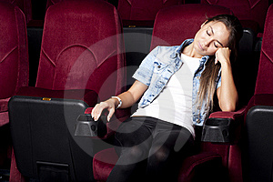 Woman Sleep In The Cinema Stock Photos - Image: 21053723
