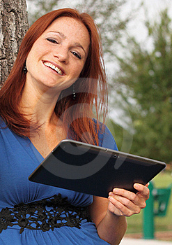Pretty Woman Using Tablet Stock Images - Image: 21069064