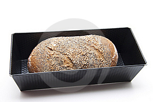 Baking Tin And More Grain Bread Royalty Free Stock Image - Image: 21105586