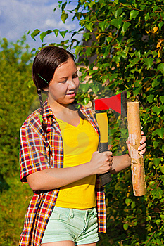 Young Woman Holding An Axe And Chock Royalty Free Stock Photos - Image: 21146428