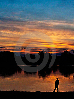 Fisherman At Sunset Royalty Free Stock Photography - Image: 21182717