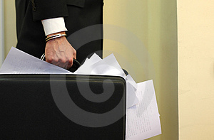 Overloaded briefcase with docu Stock Image