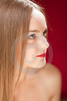 Blond Woman Looking At Red Copyspace Stock Photo - Image: 21207000