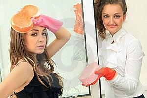 Glamour Girls Washing The Window Royalty Free Stock Image - Image: 21209766