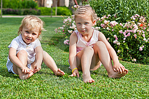 Beautiful Girls Sitting On The Green Grass Royalty Free Stock Image - Image: 21218346