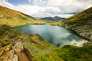 Landscape From Capra Lake In Romania And Fagaras M Royalty Free Stock Photography - Image: 21270087