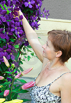 Beautiful Smiling Woman Near The Flowers Royalty Free Stock Image - Image: 21279596