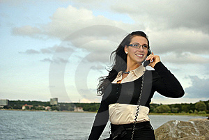 Girl With A Telephone Receiver In Hand Royalty Free Stock Photography - Image: 21302037
