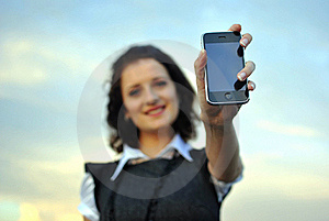 Lovely Young Woman Showing Mobile Phone Royalty Free Stock Photo - Image: 21302395