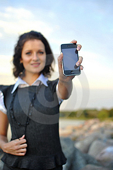 Lovely Young Woman Showing Mobile Phone Stock Image - Image: 21302401