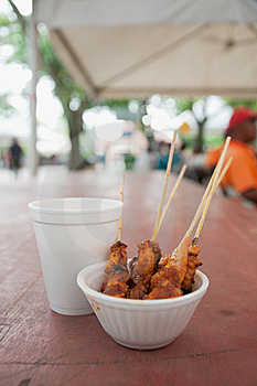 Chicken Satay In Peanut Gravy And A Soft Drink Stock Images - Image: 21309474
