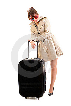 Woman In A Raincoat With A Suitcase Stock Images - Image: 21320114